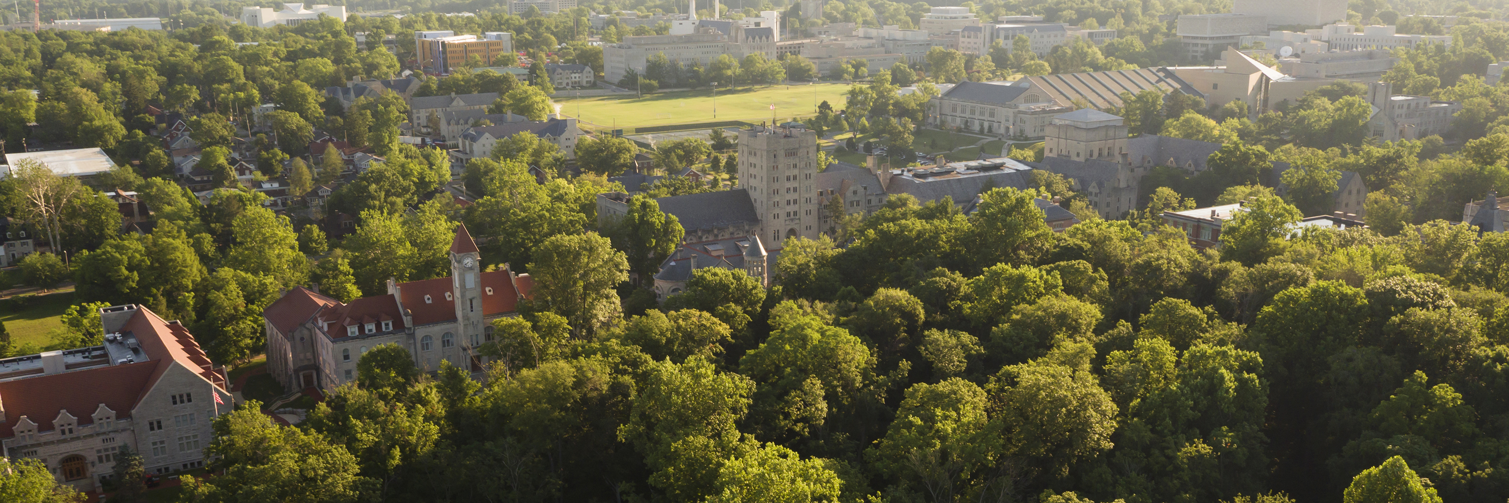 Aerial view of the forested Indiana University Bloomington campus.