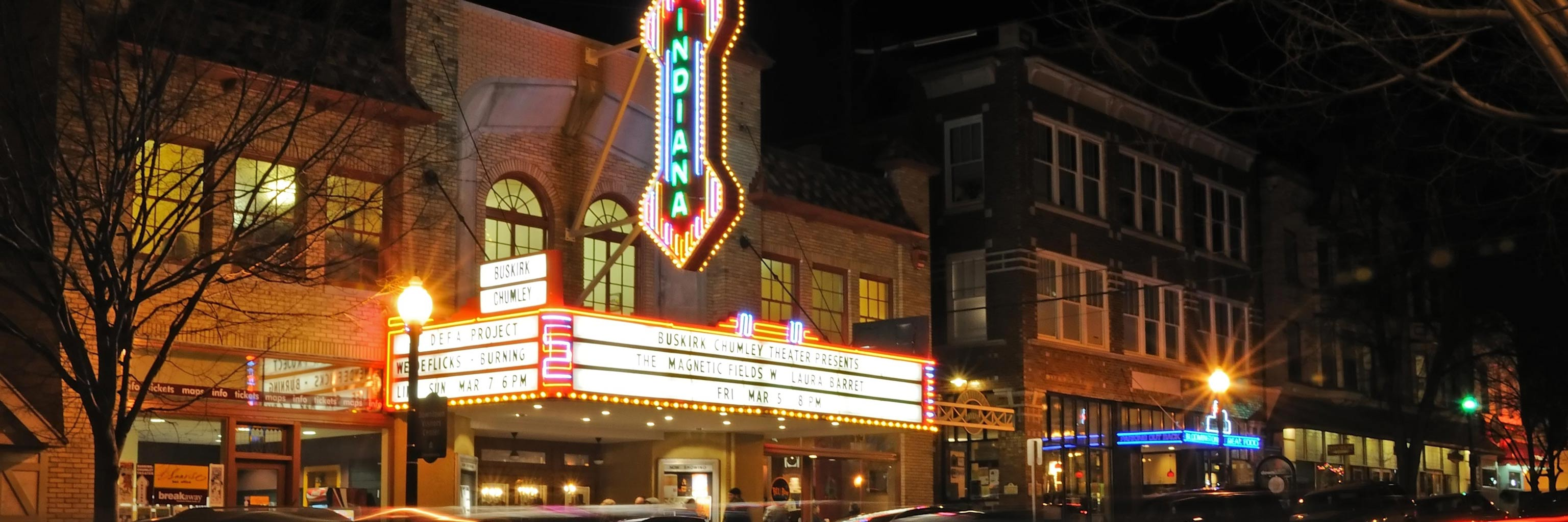 The Buskirk-Chumley Theater sign illuminated at night on Kirkwood Avenue in Bloomington, Indiana.