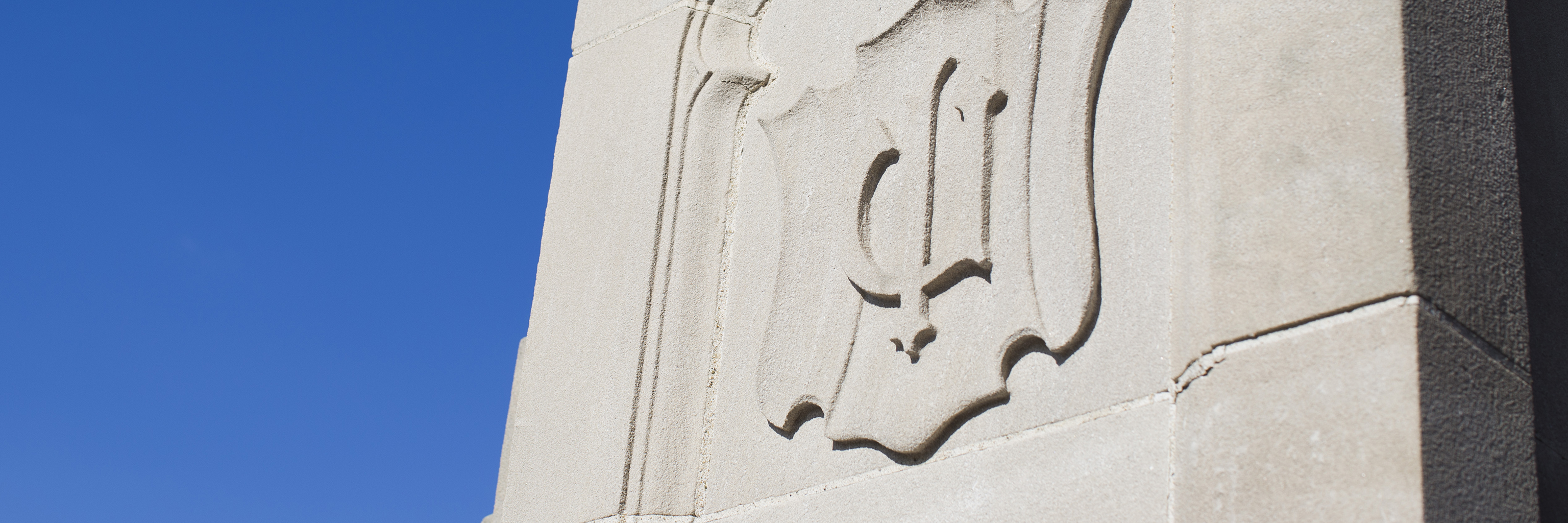 Image of a symbol carved in limestone within the Bloomington campus arboretum.