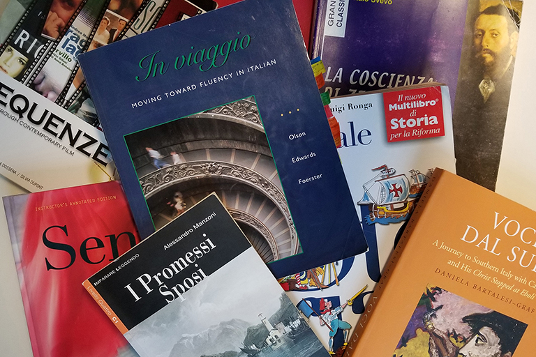 Italian textbooks spread out on a table.