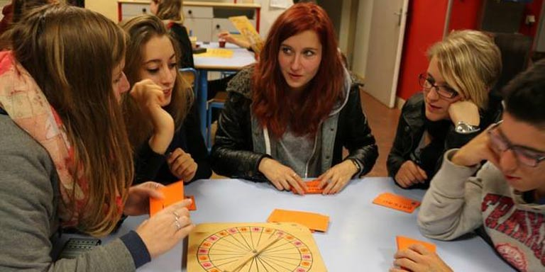 Students play a board game during French Club.