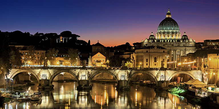 Rome, Italy illuminated at dusk.