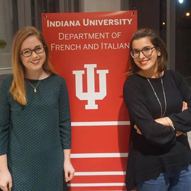 Students pose for photo with IU Department of French and Italian banner.