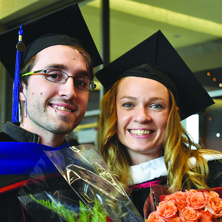 Image of Jamie Root and Rodica Frimu at commencement ceremonies in 2017.